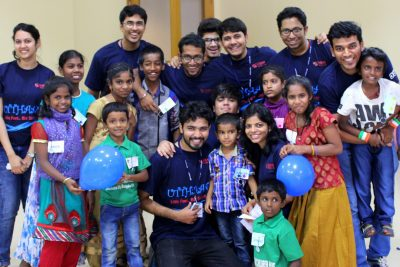 Symbiosis Students having fun with Kids